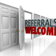 The words Referrals Welcome coming out an open door to encourage customers to refer friends and family to your business